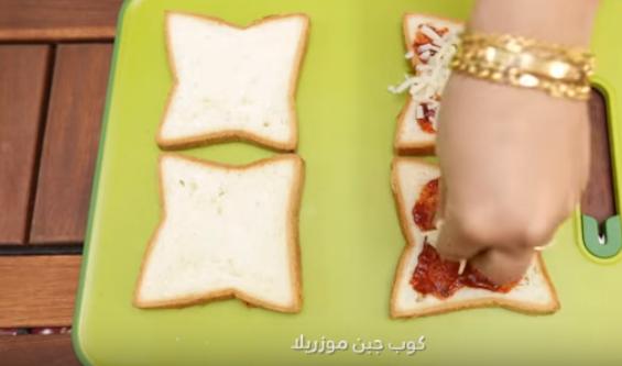 بالفيديو  ..  ساندويش بيتزا الدجاج