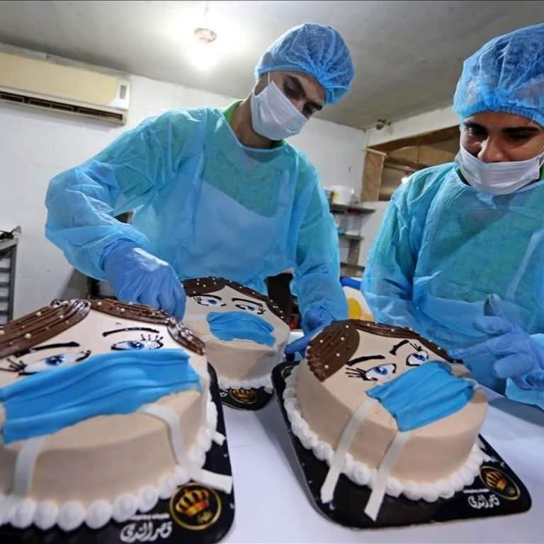 """""""كعكة كورونا"""" في غزة لتوعية المواطنين على فيروس كورونا"""