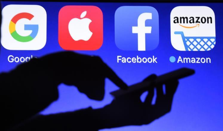 كيف يمكن تفكيك العملاقان غوغل وفيسبوك؟