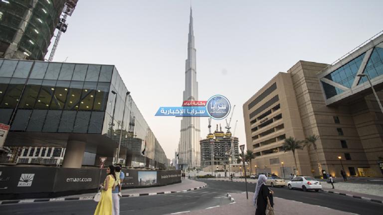 بالصور و الفيديو  ..  برج خليفة يتزيّن باللون الأخضر احتفاءً باليوم الوطني السعودي
