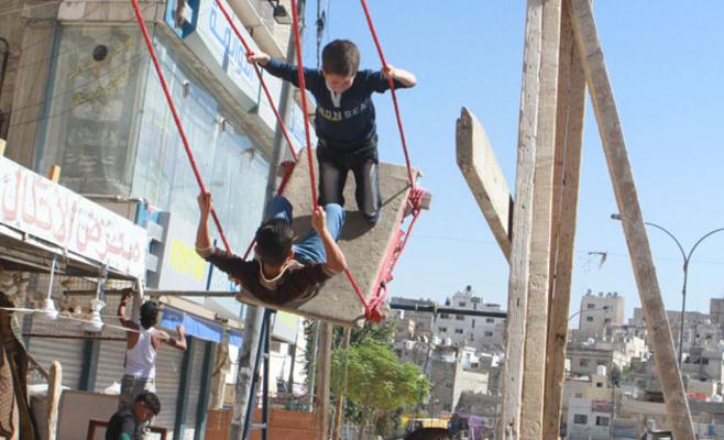 بالصور .. فرحة ثاني أيام العيد بعيون اطفالنا