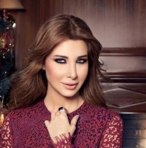 نانسي عجرم تُغرم نادي الأهلي 100 ألف جنيه