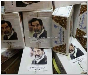 بالصور.. اردني يوزع تموراً عن روح الشهيد صدام حسين
