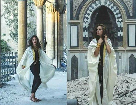 بالصور  ..  عارضة ازياء تستعرض نفسها على أنقاض مسجد أثري في حلب و تثير الغضب في سوريا
