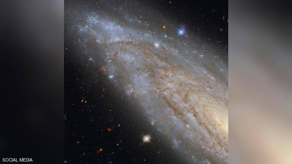 صورة مدهشة من الفضاء ..  مجرة حلزونية بثقب أسود عملاق