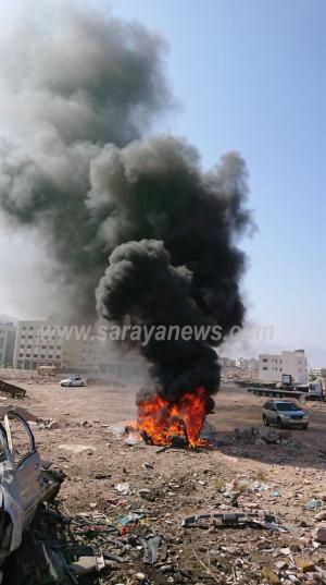 """بالفيديو والصور ..  مواطن يحرق مخلفات السيارات يتسبب باستنفار النجدة في العقبه  .. """"تفاصيل"""""""